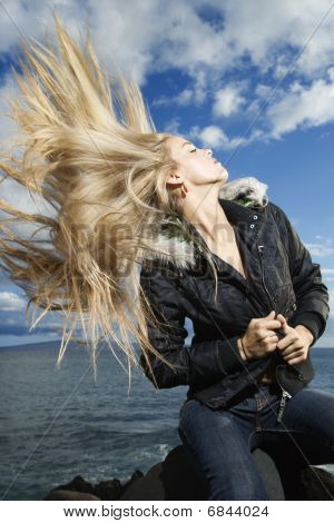 Young Woman Tossing Blond Hair