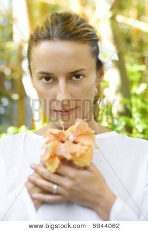 Attractive Woman Holding Flower
