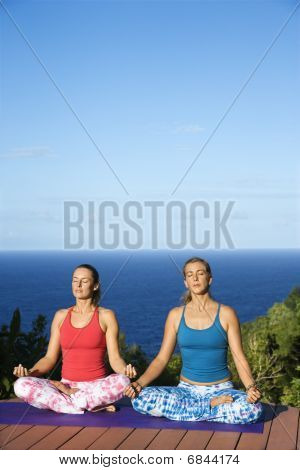 Young Women Doing Yoga