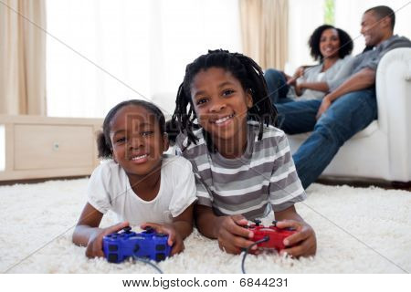 Happy Siblings Playing Video Game