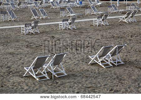 VIAREGGIO, ITALY - MAY 01: Typical Italian beach chairs in Viareggio, one of the most well known summer Italian vacation spots, on May 01,2014, Viareggio, Italy