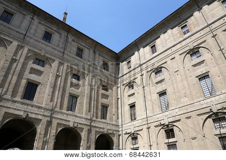 PARMA, ITALY - MAY 01,2014: Palace of Pilotta. Parma is famous for its ham, cheese and architecture. It is home to the University of Parma, one of the oldest universities in the world.