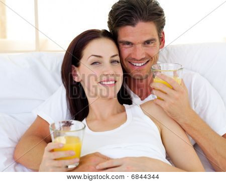 Romantic Couple Drinking Orange Juice