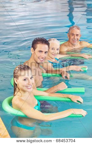 People doing aqua fitness as back training in a swimming pool