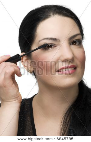 Portrait Of Woman Applying Mascara