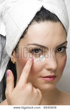 Closeup Woman Applying Cream Face