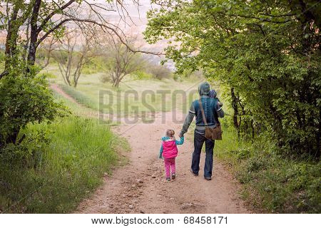 Father With Young Daughter And Son