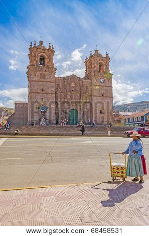 PUNO, PERU, MAY 5, 2014 - Plaza de Armas with ice-cream seller and the seventeenth-century Cathedral in the background