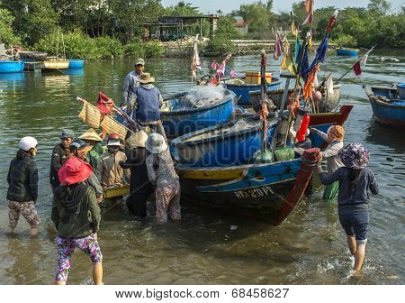 A Melee Erupts When A Fishing Sloop Lands With Fresh Fish At A Vietnamese Market.