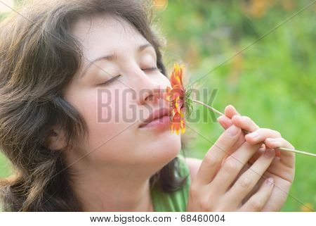 A Young Woman And Flower