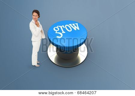 The word grow and thinking businesswoman against grey background
