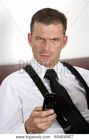 Businessman Holding Phone And Looking Upset