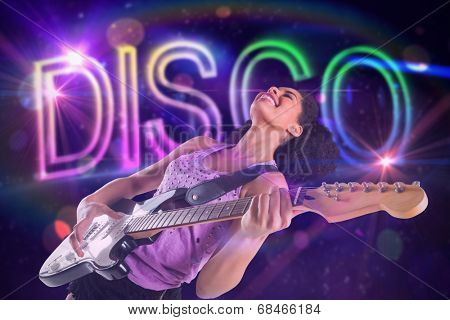 Pretty girl playing guitar against digitally generated colourful disco text