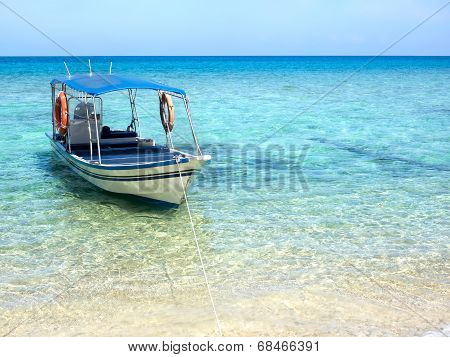 Boat Floating On Turquoise Colored Water