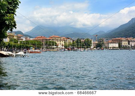LUGANO, SWITZERLAND - JULY 5, 2014: Lugano city and shoreline.The affluent city in southern Switzerland sits on the shores of Lake Lugano surrounded by the Lugano Prealps bordering Italy.