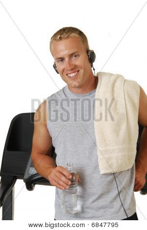 Happy Athletic Man Leaning Against A Treadmill