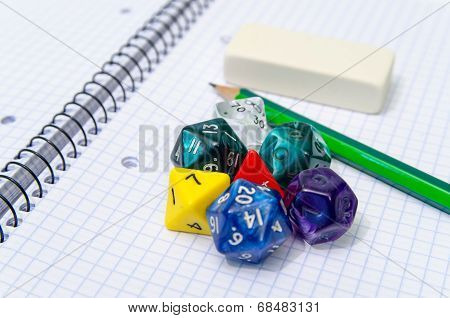 Set Of Open Exercise Book, Pencil, Rubber And Dices Isolated On White Background