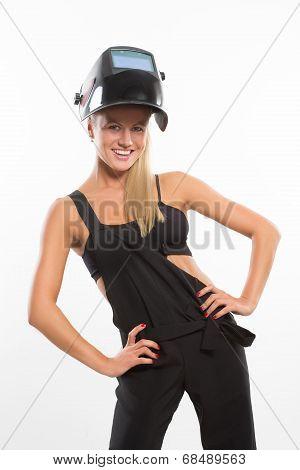 sexy smiling woman in welder helmet