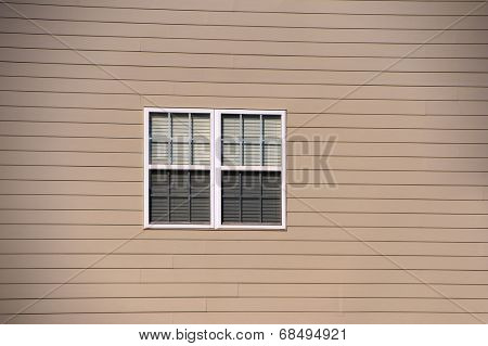 Window against vinyl siding at a local community