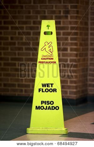 Caution Wet floor sign against a bathroom