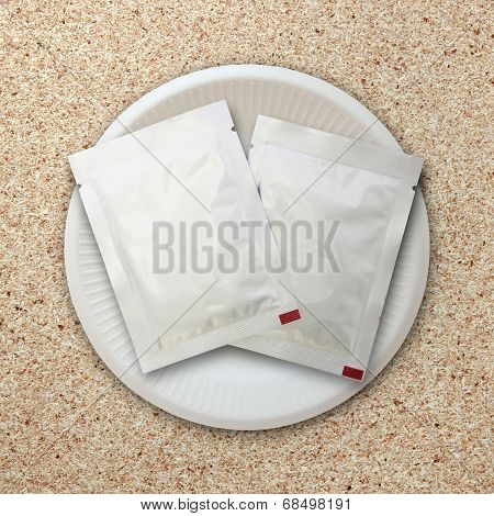 Silver Package On White Plate