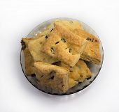 stock photo of baked raisin cookies  - Cookies with cherry and raisin on a round dish