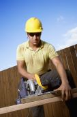 Construction Worker Sawing Wood