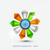 pic of ashoka  - Beautiful flower design made by cone in national flag colors with ashoka wheel on blue background for Independence Day celebrations - JPG