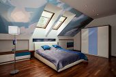 pic of attic  - Interior of blue and white bedroom in the attic - JPG