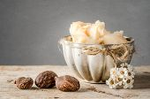 foto of cosmetic products  - Cup of shea butter with shea nuts - JPG