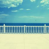 pic of balustrade  - Summer view with classic white balustrade and empty terrace overlooking the sea  - JPG