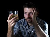 image of alcohol abuse  - alcoholic wasted man drunk sleeping looking at whiskey glass thinking and feeling temptation in alcohol addiction and alcoholism concept - JPG