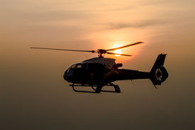 stock photo of helicopters  - The patrol helicopter flying in the sky - JPG