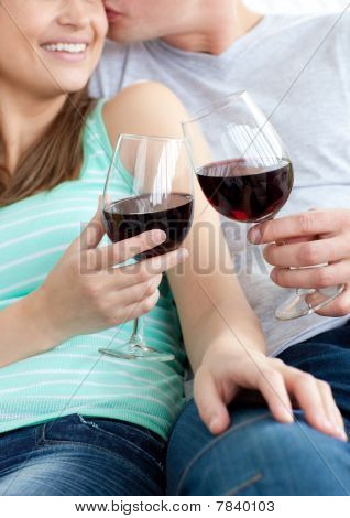 Close-up Of A Young Couple Drinking Red Wine