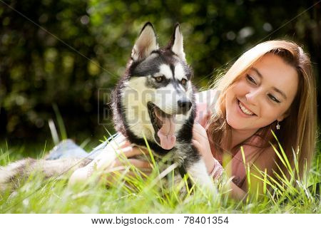 Alert Husky Dog And His Young Female Owner