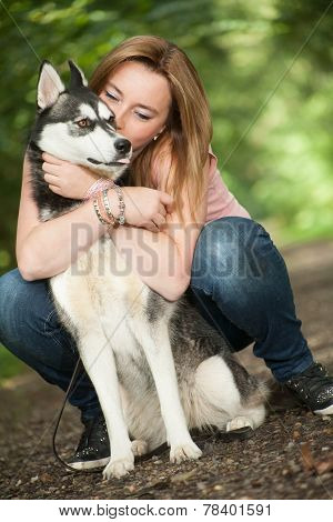 Hugging With Her Dog