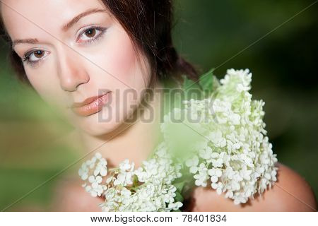 Girl With Hortensia On Her Shoulder