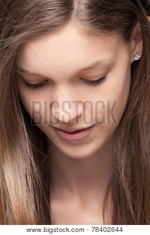 Young Girl Is Looking Down
