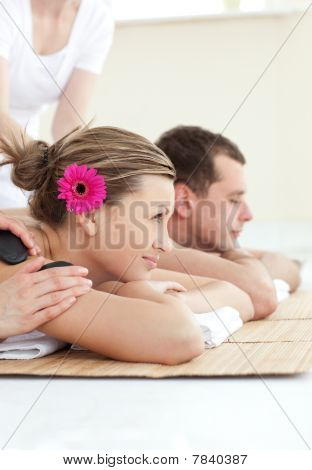 Smiling Young Couple Enjoying A Spa Treatment