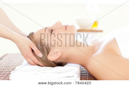 Close-up Of A Beautiful Woman Receiving A Head Massage