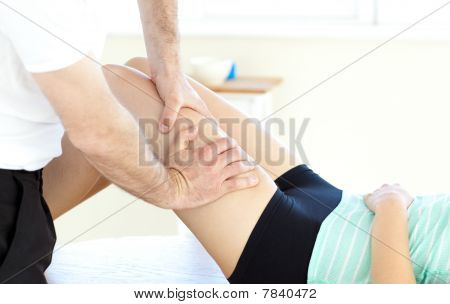 Close-up Of A Woman Receiving A Leg Massage