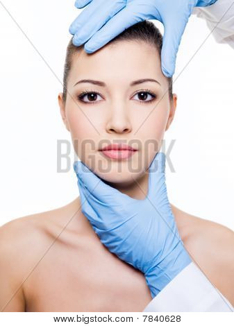 Plastic Surgery Touching The Woman Face