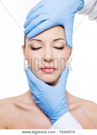 Plastic Surgery Touching Female Face