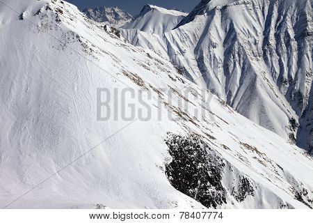 Snowy Rocks With Avalanches