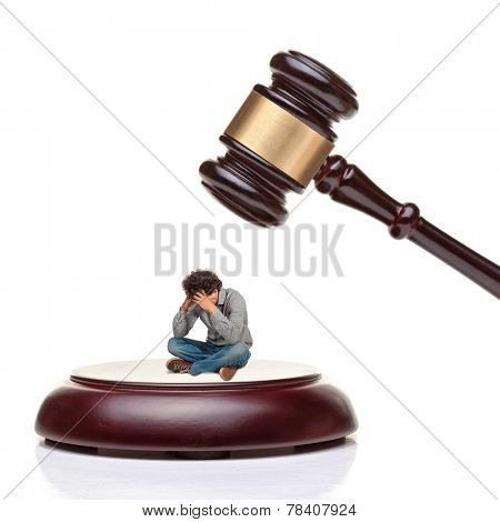 classic wood gavel and desperate man