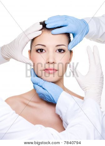 Plastic Surgeons Touching Female Face