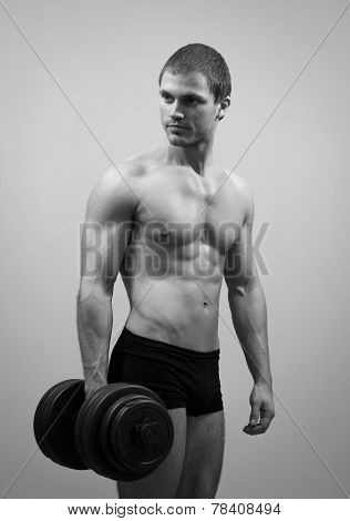 Handsome Muscular Male Model With Dumbbell. Black And White.