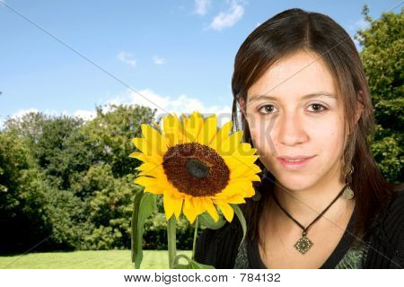 girl outdoors with a sunflower