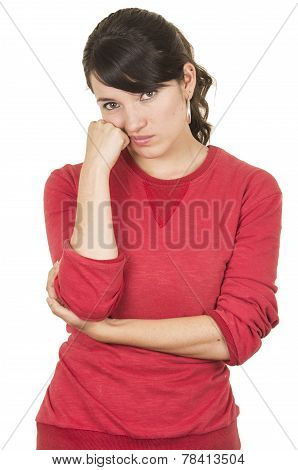 pretty young girl wearing red top posing with hand on cheek looking bored