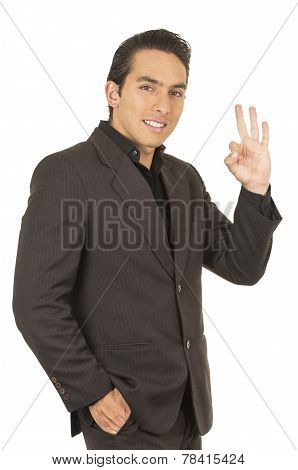 handsome young man wearing a suit posing gesturing all right